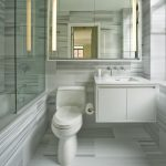 Over The Toilet Storage Grey White Floor Walls Tile Mirrored Cabinet White Floating Cabinet Wall Mounted Faucet Sink Glass Shower Door Tub Wall Sconces