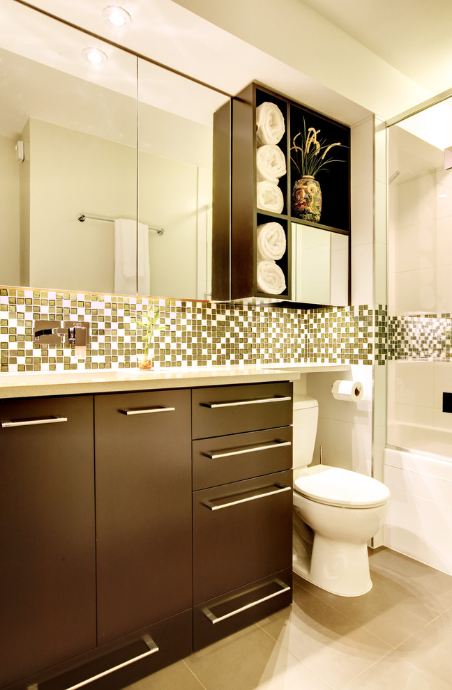 over the toilet storage mirrored cabinet open shelves mosaic backsplash brown vanity wall mounted faucet sink recessed lighting glass door