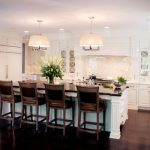 Romantic Kitchen With White Ornamented Cabinet, Island, White Drum Pendants