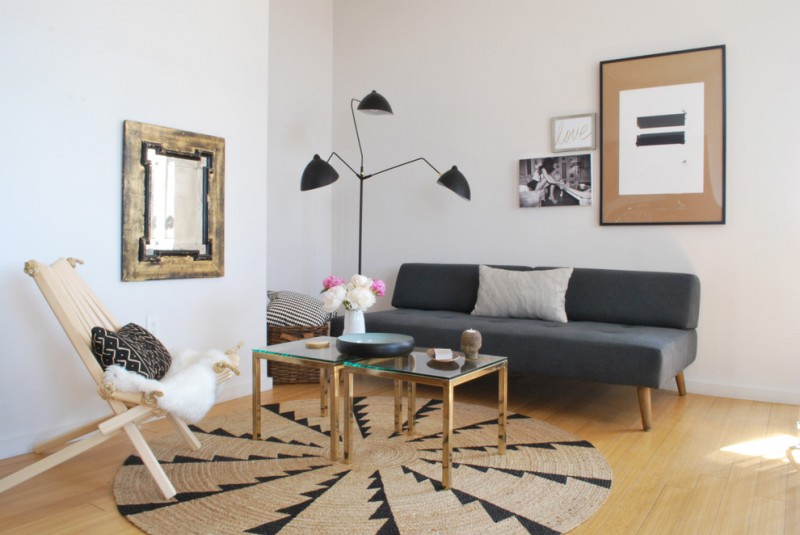 round area rugs for living room three arms floor lamp dark grey couch wooden chair glass coffee tables wall mirror rattan basket white walls