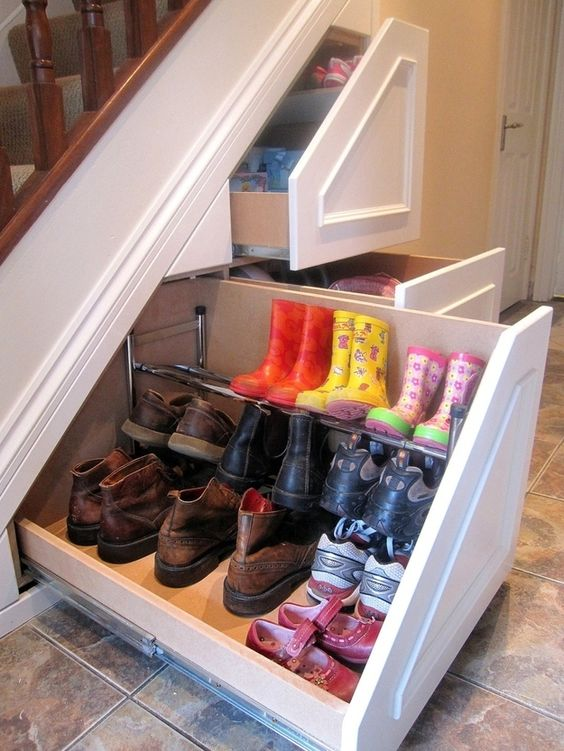 sliding shoes storage under the stairs