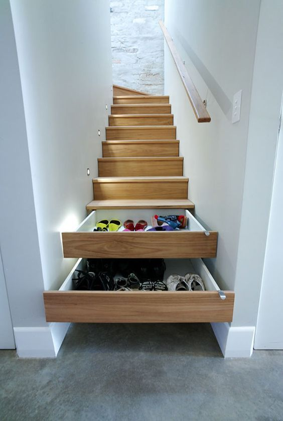 storage inside the wooden stairs that is slide forward
