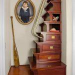 Storage Stairs In Dark Brown Wooden With Golden Metallic Handrails