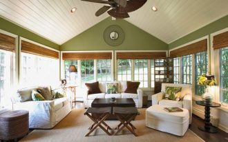 unusual ceiling fans vaulted ceiling round decorative mirror rattan window shades white framed windows and doors white sofas wooden coffee table area rug