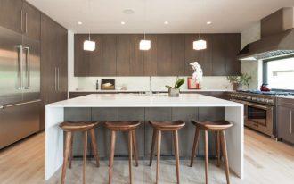 wood stool white island wooden flat panel kitchen cabinets refrigerator white countertops cube pendant lamps stove range hood oven window sink backsplash