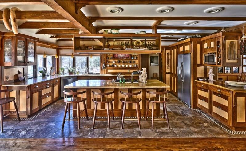 wood stool wooden kitchen cabinets wooden island yellow countertops dishwasher windows pendant lamps refrigerator stovetop undermount sink