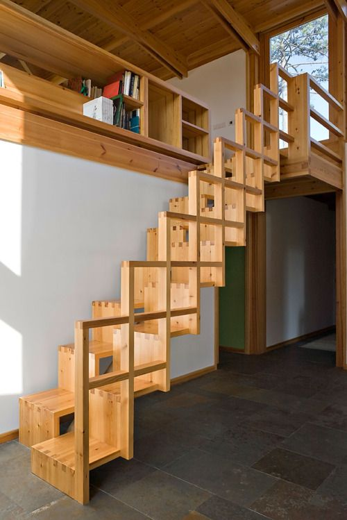 wooden stairs zigzag in small space with squares handrails
