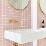 Bathroom Sink With Pink Square Backsplash, Golden Faucet, Golden Framed Round Mirror