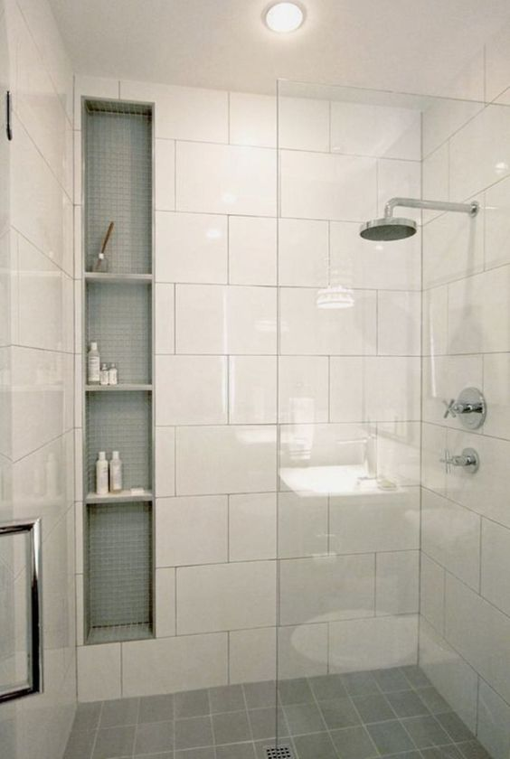 bathroom with big white square tiles on the wall, grey square tiles on the floor,