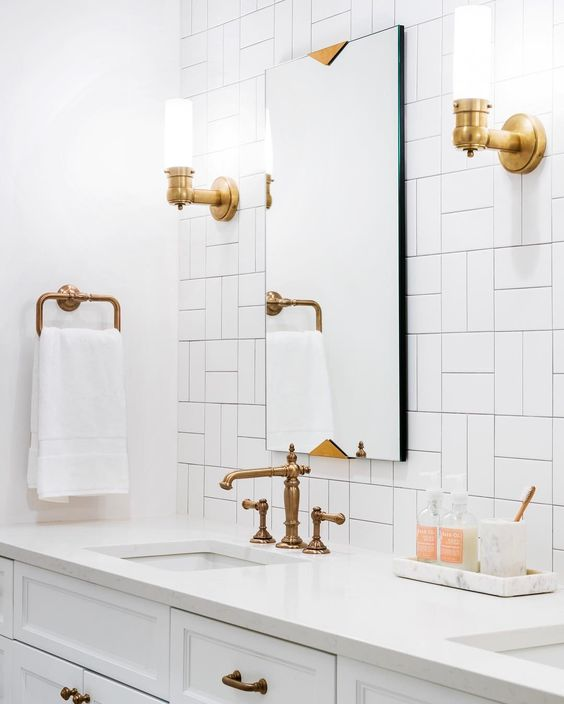 bathroom with white tiles, white sink and cabinet, square mirror, golden faucet
