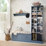 Coat Rack Wall Mount Blue Bench Blue Cubbies Bench Storage Striped Cushion White Walls Beige Area Rug Rattan Baskets Pillows