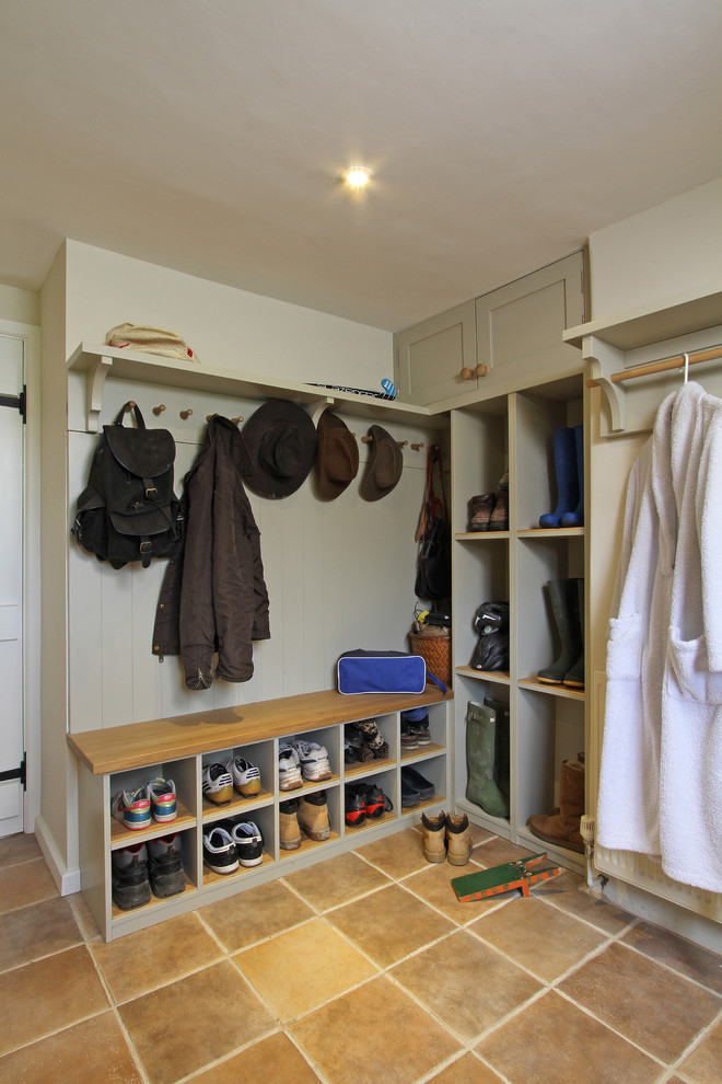 coat rack wall mount brown floor tile wooden bench with cubbies shoes storages grey cabinet ceiling lamp shelves