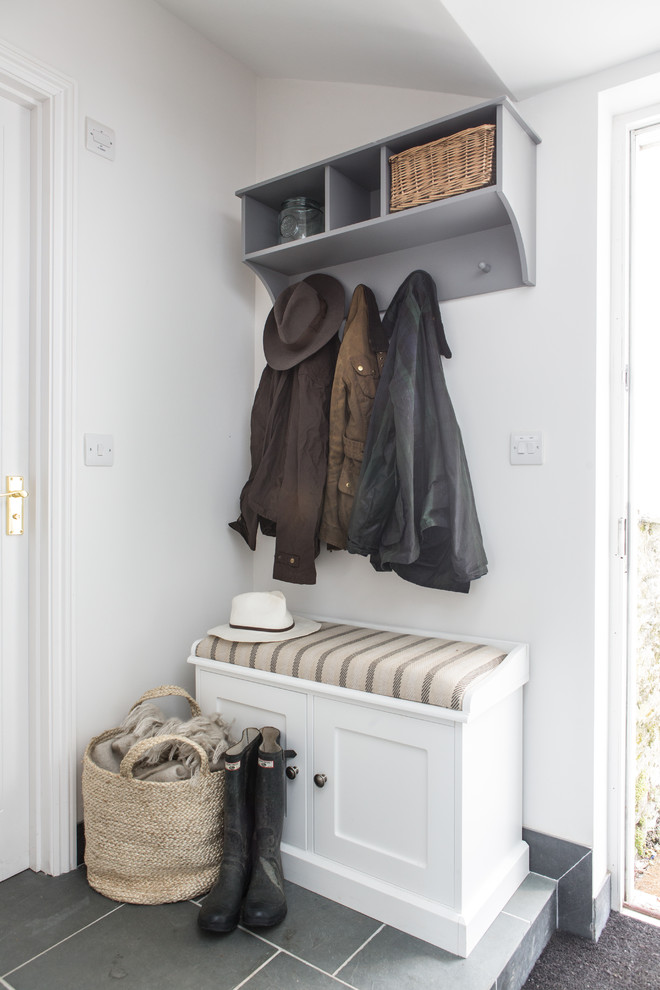 coat rack wall mount grey rack white wooden bench striped bench cushion gray floor tiles baskets bench storage white walls