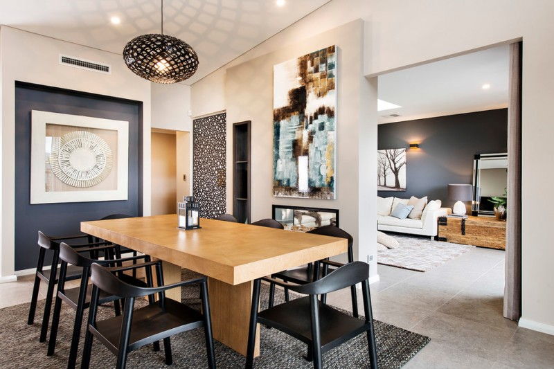 dining chair modern black chairs wooden dining table pendant lamp grey textured rug grey floor tile colorful artwoorks shelves
