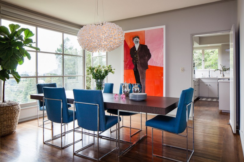 dining chair modern blue chairs brown dining table white chandelier wooden floor colorful artwork grey wall windows indoor plant