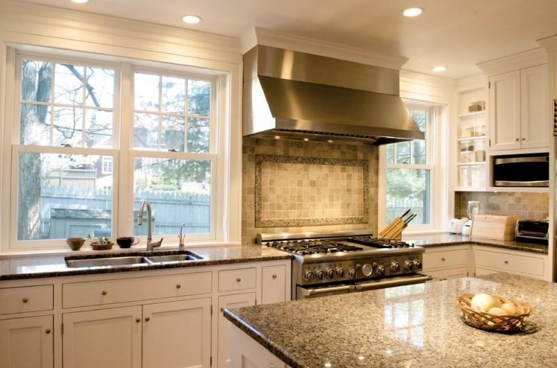 elkay lustertone sink faucet black granite countertops white island white cabinet glass windows rangehood stove shelves backsplash recessed lighting