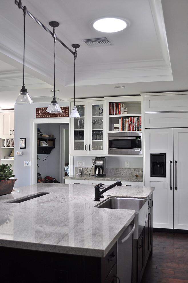 elkay lustertone sink glass dome pendant lamps white cabinets black island white granite countertop bookshelves black faucet wooden floor