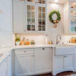 Fireclay Farm Sink Glass Cabnet Doors White Cabinets Dishwasher White Subway Backsplash White Marble Countertops Stovetop Recessed Light Kitchen Mat