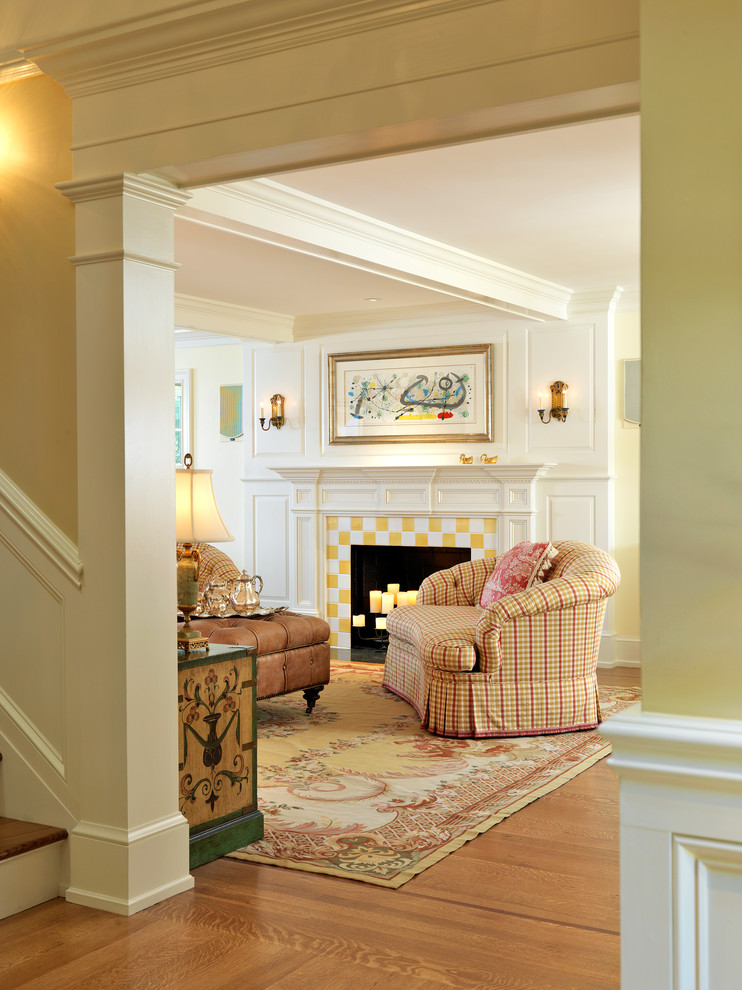 fireplace candle ideas area rug brown ottoman table lamp patterned armchairs white mantel artwork wall sconces wooden floor