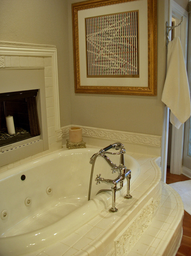 fireplace candle ideas built in tub artwork tub filler whte mantel towel holder wooden floor grey walls white bathroom mat