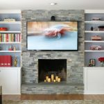 Fireplace Candle Ideas Stacked Stones Wall White Built In Cabinets And Shelves Wooden Floor Area Rug Tv Unit Chair Sofa Pillows