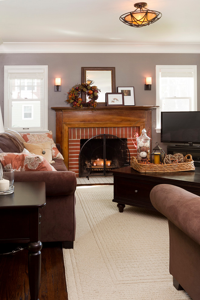 fireplace candle ideas wooden mantel wall sconces brown velvet sofas wooden coffee table with drawers throw pillows sde table windows area rug
