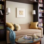 Home Library With Brown Wooden Bookcases With Nook Filled With Sofa, Round Coffee Table