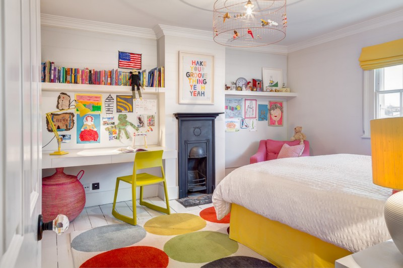 kids bedroom desk unique lighting colorful rug white bedding yellow bed pink armchair white desk yellow chair yellow valance table lamp shelves