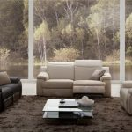 Living Room With Recliners Glass Coffee Table Brown Shag Area Rug Black And Beige Sofas Glass Windows White Floor Tile Pillows