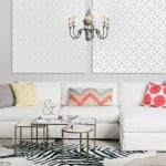 Nesting Cocktail Table White Couch Colorful Throw Pillows Cowhide Rug White Side Table White Table Lamp Chair Hrey Shad Rug Chandelier