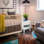 Nursery With White Walls, White Black Wallpaper, White Wooden Baby Box, Grey Chairs, Blue Rug, Brown Leather Ottoman