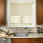 Roll Up Window Shade Undermount Sink Faucet Dishwasher Granite Countertop Beige Backsplash Wooden Cabinets White Framed Glass Window