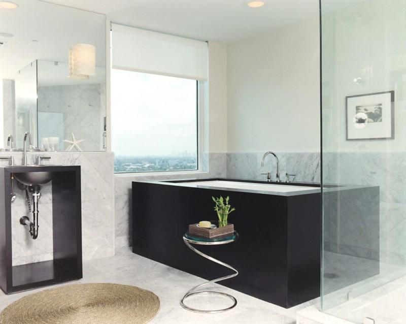 roll up window shade wall sconce black bathtub glass side table glass shower door tub filler black freestanding sink wall mirror