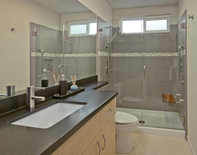 solid shower base beige vanity dark brown top sink faucet sliding glass window glass shower door wall mirror built in bench toilet