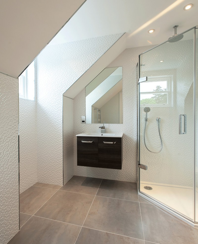 solid shower base glass shower door wall mirror white textured walls black wooden floating vanity white sink faucet window recessed lighting