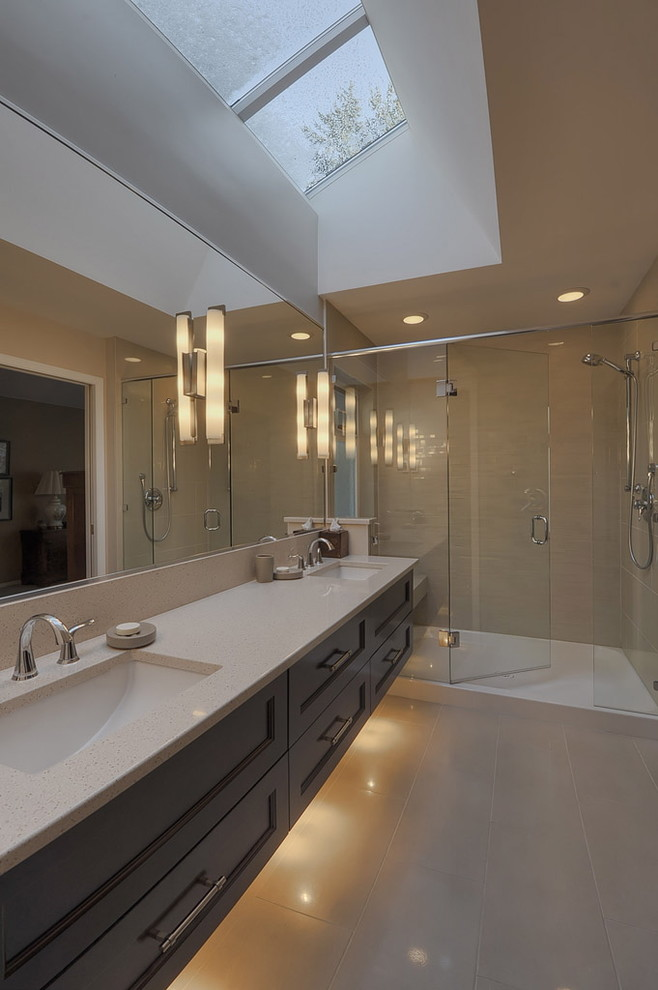 solid shower base wall sconces floating double vanity sinks faucets wall mirror glass shower doors recessed light skylight window