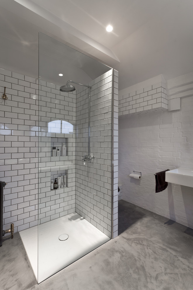 solid shower base white subway walls tile toilet glass sower wall waterproof concrete floor built in sink towel holder recessed light