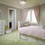 Underbed Storage Solutions Pink Bedding Green Shag Rug White Bed Pillows Artwork Pink Curtains Crystal Chandelier White Drawers Windows