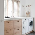 Clean Kitchen With Light Brown Wooden Cabinet, White Marble Top, White Washing Machines Under
