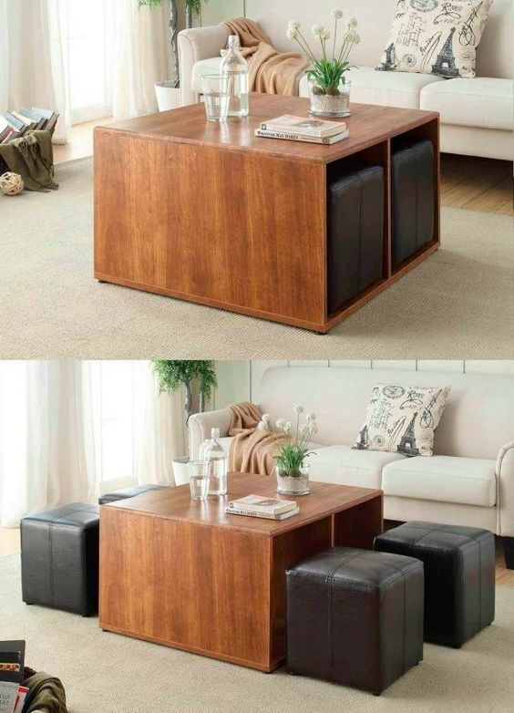 a brown wooden coffee table with black leather chairs inside