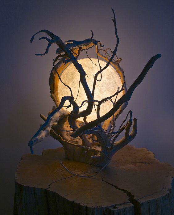 an orb lamp inside a tangled branch