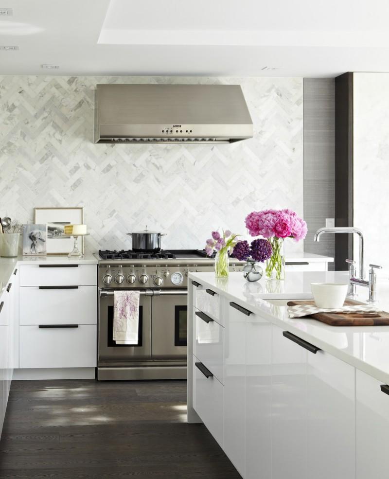 backsplash texture herringbone backsplash dark brow wooden floor white cabinets white island white countertops stovetop oven sink faucet rangehood