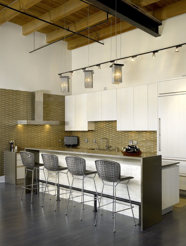 backsplash texture white cabinets brown backsplash tile white island modern bar stools sink stovetop range hood industrial pendant lamp grey floor tile