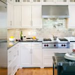 Backsplash Texture Wooden Floor White Cabinets Black Granite Countertop Stovetop Rangehood Recessed Lighting Island Refrigerator Blue Granite Countertop