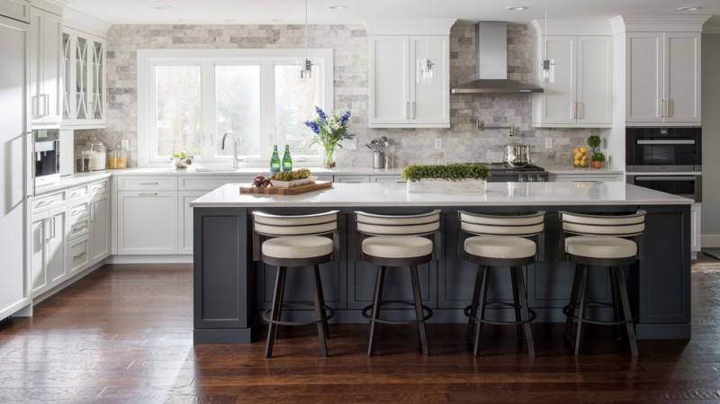 backsplash texture wooden floor white cabinets grey island white countertops extractor fan stovetop built in shelves sink white windows barstools pendant lamps