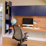 Bamboo Desk Top Dark Blue Upper Cabinet Dark Blue Vertical Bookshelves Chrome Table Lamp Globe Wooden Floor Black Office Chair