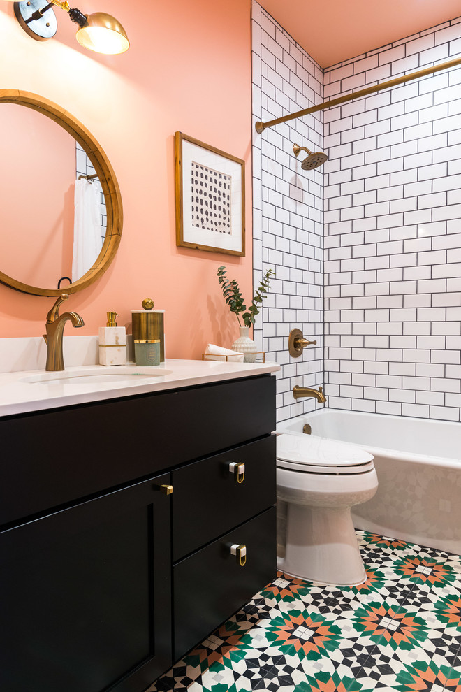 bathtub cartridge tub rustic gold shower fixture white wall tile patterned floor tile black vanity sink round wall mirror wall sconce