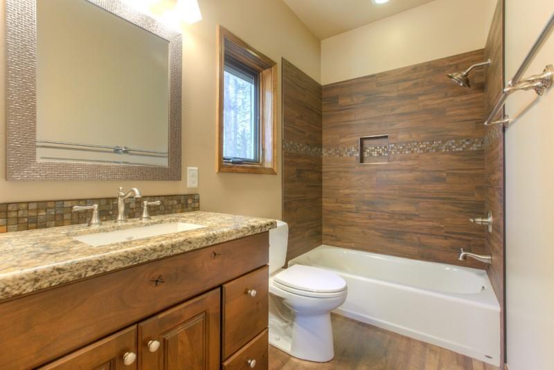 bathtub cartridge wooden wall tile built in tub shower head wooden vanity sink granite countertop wall mirror window