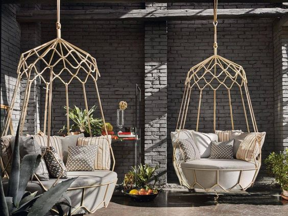 bed swing ottoman from rattan with white suchioin and pillows