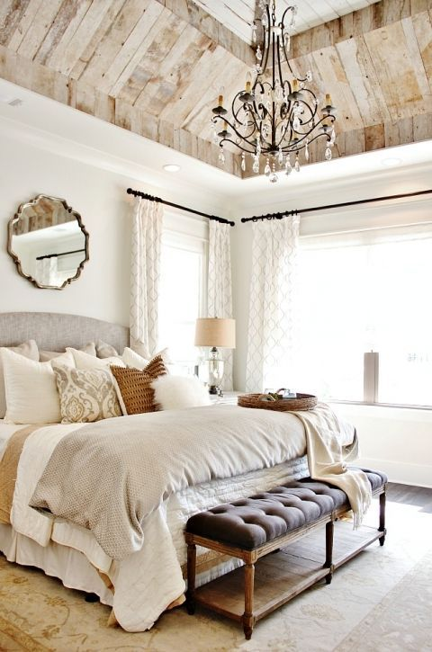 bedroom with white wall, wooden floor, brown accent, brown wooden tray vaulted ceiling
